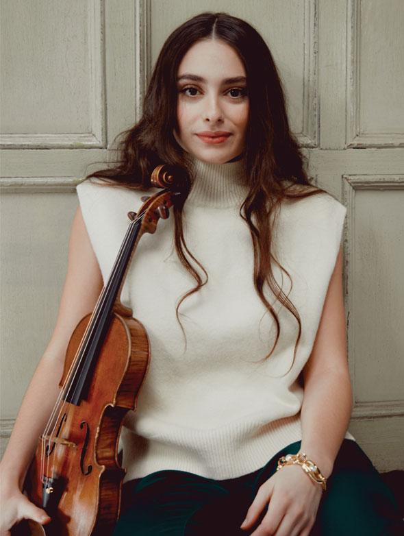 Esther Abrami plays Larsen Aurora